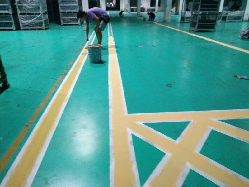 南京汽配厂正在涂装哥拜耳水性矿物地坪涂料